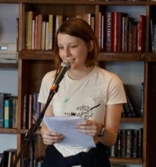 Roosevelt WITS student reading at Cathedral Coffee