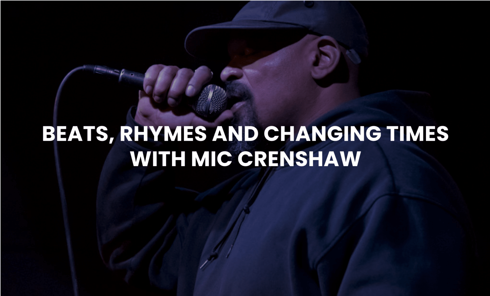 Image of MC and poet Mic Crenshaw performing